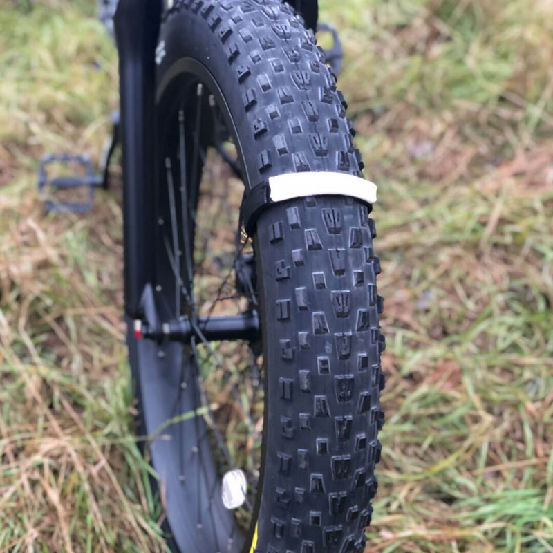 Scent Strap on tire of fat wheel e-bike