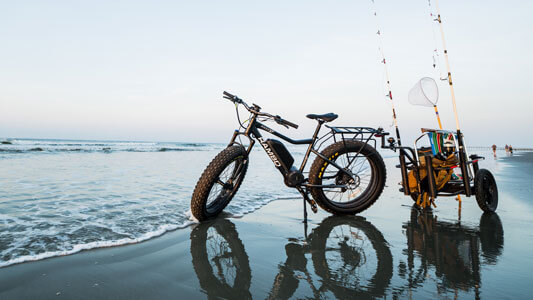 High Performance Electric Bike at Ocean with trailer to go fishing